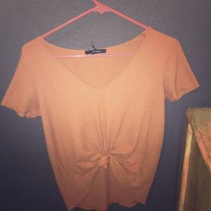 burnt orange patterned print shirt